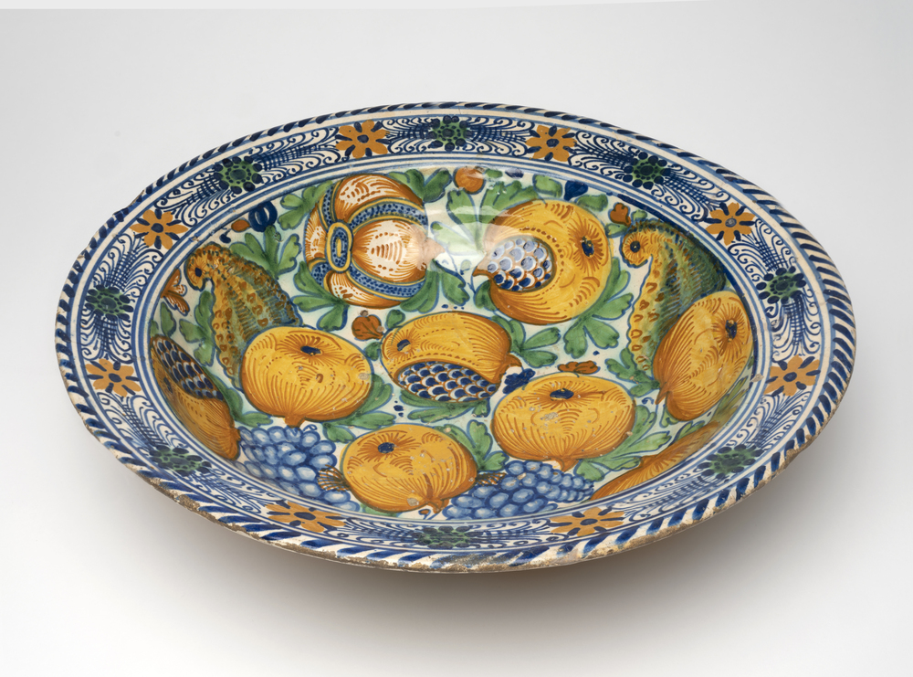 'Clapmash' bowl with pomegranates, grapes and foliage